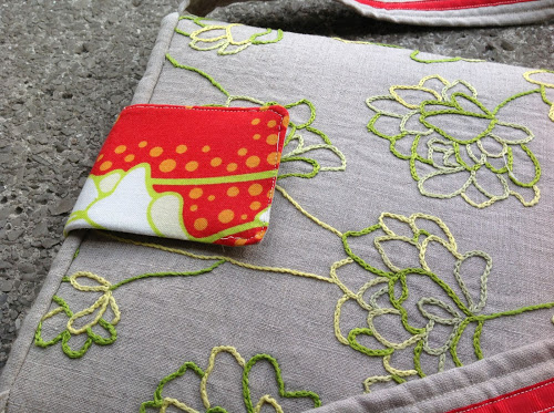 Designer fabric embroidery – iPad slipcover with strap
